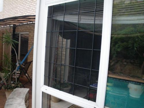 Double bunger! – temporary fixed window screen & a non-compliant sliding door