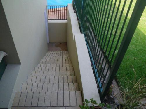 Mightn't be able to fall down steps from lawn area but can clearly walk down top of wall