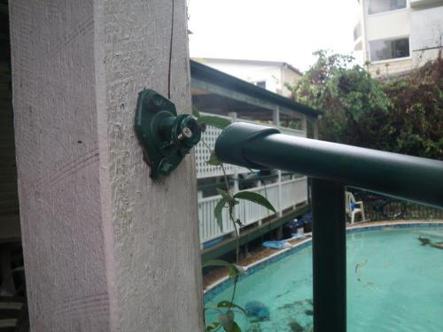 Broken top rail fitting at end of pool fence panel
