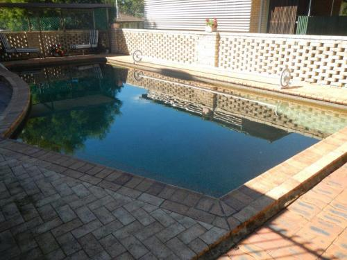 Breeze block boundary fencing provides ladder effect & direct access to pool zone