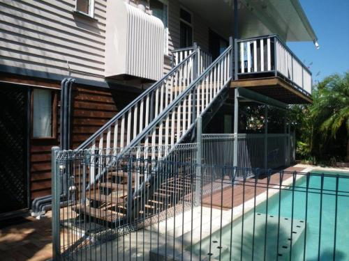 Climb along the outside of the house steps, over fence & in the pool