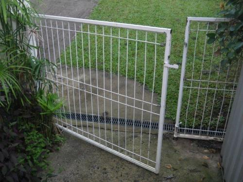 Garden gate at front of property leads directly into unfenced pool zone