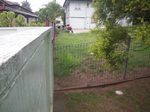 Climbable garden fence abuts a 1600mm block wall