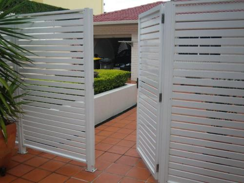 Expensive aluminium fence adjacent to otherwise unprotected pool zone isn't fitted with self-closing or self-latching hardware